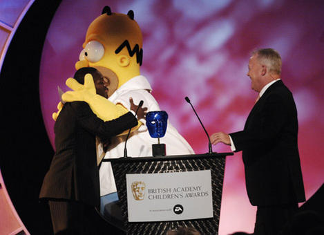baftaengland-footballer-shaun-wright-phillips-receives-a-warm-welcome-from-homer-simpson-whose-movie-won-the-bafta-kids-vote-in-association-with-electronic-arts-506.jpg